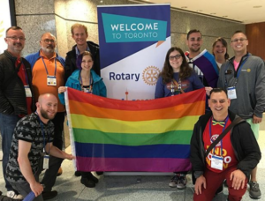 Group of Rotarians with a Pride flag at the 2018 Rotary Convention in Toronto